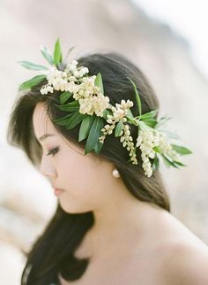 A simple floral crown of pieris and greenery | Brides.com