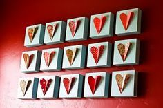 Spray paint little canvas squares or use tissue paper and decoupage wood blocks,mdi board, foam board, ect.  Cut out hearts from copied pictures of loved ones and mix with red and pink papers.  Glue and decoupage one flat heart, then one folded heart on top.