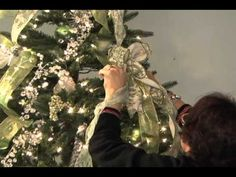 Awesome video tutorial on how to decorate a christmas tree with ribbon! I'm going to do this when I put up our trees this year!