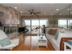 Tranquil Waterfront Living in this beautiful, immaculate townhouse! Enjoy Breathtaking Panoramic WATER VIEWS and the most Magnificent Sunsets! Bay Front with 30' BOAT SLIP, dock and direct water access. Short walk to beach and boardwalk. Many new upgrades, including newly painted interiors and exteriors, large Designer Kitchen with 64 sf of stunning new granite counter tops and new stainless appliances. Built in FP, Hunter Douglas window treatments, custom Plantation shutters, pets allowed.