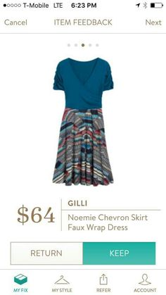 I love the colors and patterned bottom of this dress! Also love the wrap and sleeves.