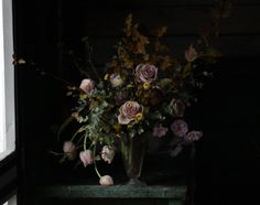 Saipua  Really love how dark and moody this arrangement is. Love the dusty roses with the dark greens, and even love how the flowers are spilling out.