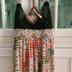Free people top Adorable top yellow small beads with 4 red beads on vneck. Yellow red black flowers with blue yellow circles. Criss crosses in back. Tie in back to make tighter. Nwot Free People Tops