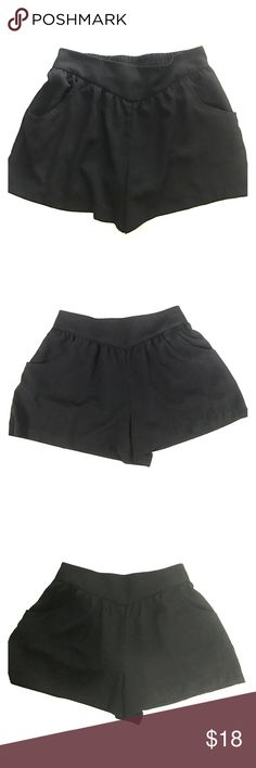 """Black dress shorts elastic back pockets in front S Black dress shorts. Pockets in front. Elastic back. Size small (s/P) . Brand is Xhilaration. Measures approximately 2 3/4"""" inseam and almost 26"""" waist without stretching the elastic. Elastic will stretch a lot. Length from top of shorts to bottom is a little over 12."""" GUC. Bundle with other items in my closet to save even more. Shorts"""