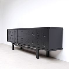 1970 Large ebonized full oak sideboard with graphic doors and inside a white ash veneer interior. Belgium made as i only find these sideboards in Belgium. Can be disassembled for transport.
