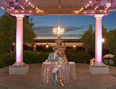Chandeliers are such a beautiful addition to the sweetheart table! Mount Palomar Winery, Temecula, CA.Wedding Tablescape Mount Palomar Winery, Temecula, CA. #Wedding #Weddings #Love #WeddingPhotography #MountPalomarWinery #RealWedding #Weddingday #Weddingflowers #WeddingFlorals  #Weddinginspiration #Weddinginspo #Weddingideas #Winerywedding #Winecountry #Romantic #Vineyardwedding #Temeculawedding #Weddingplanning  #WeddingVenue #SweetheartTable #OutdoorWeddingVenue #Uplighting #Glitz