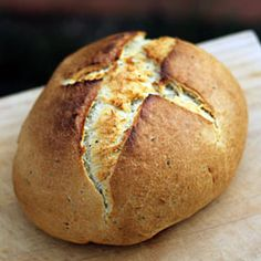 It is unbelievably easy to make this crusty artisan herb bread in your own home! Forget huge bakery prices, this loaf is sure to impress.