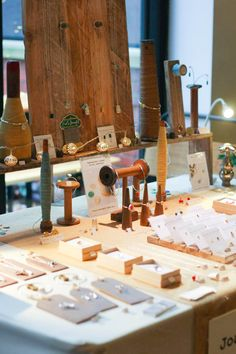 Wooden bobbins become a display feature at Joanna Wakefield's jewellery stall at the Weekend of the Maker