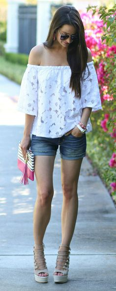 Casual spring and summer outfit idea! White lace off the shoulder top with cuffed jean shorts, lace up gladiator wedge sandals, and pink/white accessories.