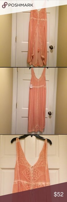 Free People Riptide Tank A high and wide front slit leaves you feeling leggy in The Riptide Maxi Tank, a sleeveless hi-lo silhouette styled with embroidered eyelet and a tasseled drawstring waist. V-neck . Partial front button closure . Unlined. Size XS. New with tags. Peach color. Goes great with skinny jeans. Free People Tops Tank Tops