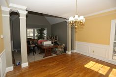 Dining Room repainted BM Concord Ivory (SW Gateway Gray on walls in living room in background)