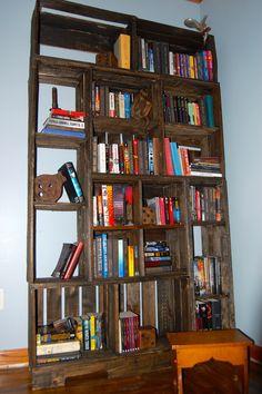 1st section of 7 feet tall wall of pallet bookshelves. My husband rocks!