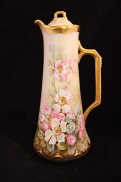 This coffee, tea or coco pot has a lovely hand-painted dogwood motif in pinks, sage greens and silver blues on a cream background. Made by Elite Works of Limoges, France this piece as made in the late
