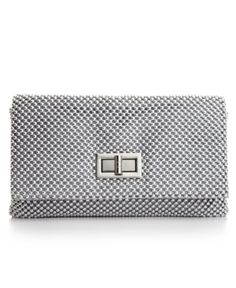 """Jessica McClintock Ball Mesh Envelope Evening Clutch-Mesh madness. Glimmer like the glamazon you are inside with this stunning mesh design from Jessica McClintock. Shimmery circular overlay envelops the sleek style fronted with a chic turnlock & topped with a slinky chain strap with 11"""" drop Turnlock closure Silver-tone hardware; Interior features zip pocket Sale Price 29.99 Check out the hottest fashion trends here…"""