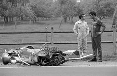 Jackie Oliver waits for a lift after disintegrating his Lotus in qualifying. French GP at Rouen 1968.