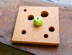 """Tamara Petrovic - Fruit Play is a fruit plate made from a thick slab of cork with holes cut out in different sizes. Bright fruit not only looks great in contrast with the natural brown cork, but the softness of the material and the size of the holes ensure that the fruit makes minimal contact with the container, """"extending fruit shelf life and staging each piece openly."""""""