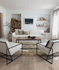 Bright whites, black steel, and natural tones ✨ Interior Designer Anissa Zajac of @HouseSevenDesign reimagined her family room in White Performance Washed Linen for the perfect all-season look // The Dune and two Mercer chairs in White Performance Washed Linen. #whitelivingroom #whitesofa #slipcoversofa #customsofa #customlivingroom