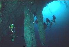 Divers in the Great Blue Hole. Cannot believe my daughter did this! I sure couldn't