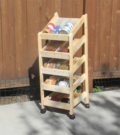 I want to make this!  DIY Furniture Plan from Ana-White.com  I am a couponer, one of those crazy ladies that needs more space than she ever has. And, as such, I needed an organized and easy way to store canned goods while making sure nothing was expiring or going to waste. They sell fancy contraptions that do such a thing, but in the nature of trying to save a few bucks, I knew I had to make one myself.