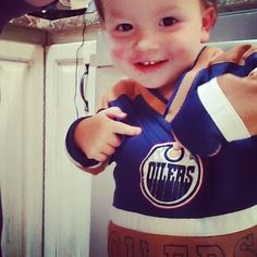This little boy knows what team is best! - Rachelle Lowry