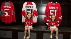 Harper and Everley Campbell take a photo in the locker room.