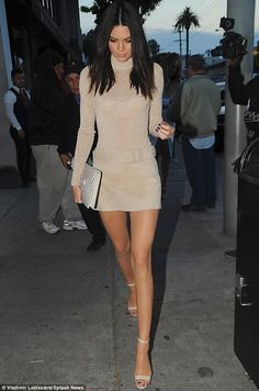 Stylish strut: Kendall Jenner brought her signature catwalk to the sidewalks of Craig's Restaurant in Los Angeles on Thursday where she was celebrating her Calvin Klein campaign with her family