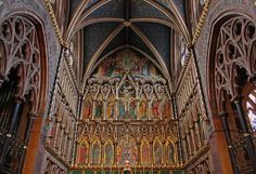 "https://flic.kr/p/57rAB4 | Sanctuary in All Saints | ""The chancel, one of the most sumptuous and dramatic in London, occupies almost one-third of the length of the church - a reflection of the Tractarian requirement that the Sacraments be stressed above the Word. Its size, the grand and ornate reredos, the gradual enrichment of the decoration as one moves further east, the position of the windows casting shards of brilliant light (weather permitting) across the vast chamber, all aid in ..."