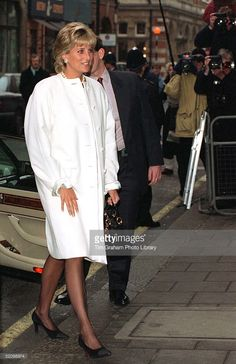 January Princess Diana arriving and departing Browns hotel for a private lunch with the American Correspondents Association, in Mayfair, London, England. Princess Diana wears a white coat and white dress underneath Princess Diana Photos, Princes Diana, Princess Of Wales, Long White Coat, Versace Coat, Diana Fashion, Uk Fashion, Thing 1, Diane