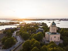 This is Suomenlinna fortress island during sunset in Helsinki, Finland. The building on the foreground is the island church which also doubles as a fully functional lighthouse. Monuments, Helsinki Things To Do, Visit Helsinki, Lds Blogs, Road Trip, Bon Point, Blog Voyage, Latter Day Saints, Drone Photography