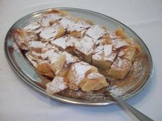 Bougatsa (Greek Cream-Filled Phyllo Pastries) from Food.com: You can buy these at every corner bakery in Greece and there are other, smaller shops that specialize in this pastry as well, so we don't actually have to make our own. This recipe is from when I lived in Canada and HAD to have one! This looks like a long recipe, but it really isn't. I just gave very detailed instructions on how to fold the pastry up properly to enclose the custard filling.