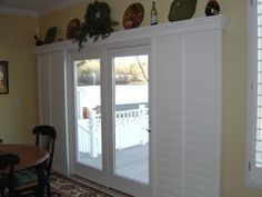 So much nicer then dusty drapes or those ugly vertical Blinds ! Sliding shutters for a sliding glass door. - Home Decor Pin Sliding Door Curtains, Sliding Door Window Treatments, Sliding Patio Doors, Sliding Glass Door, Glass Doors, Sliding Windows, Panel Curtains, Patio Door Valance Ideas, Door Coverings