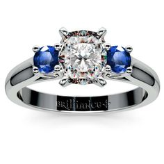 More September birthstone beauty from Brilliance: Envision the rich blue hue of round sapphires with a classic center stone cut on your finger... Introducing the Cushion Round Sapphire Gemstone Ring in Platinum! http://www.brilliance.com/engagement-rings/round-sapphire-gemstone-ring-platinum