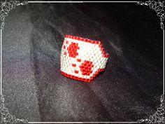 Anillo de miyuki huellitas de gato. Se puede personalizar en los colores deseados...