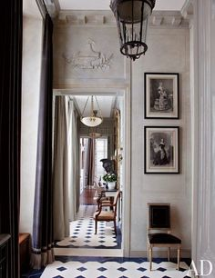 Gogeous details in this Parisian space with beautiful floor tiles and vintage art pictures