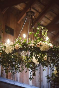 white hydrangea and greenery chandelier with bulbs