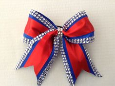 Cheer Bow-blue,red and rhinestones. by RouzandLezar on Etsy https://www.etsy.com/listing/215686077/cheer-bow-bluered-and-rhinestones
