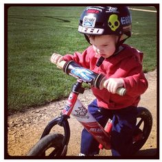 Tate Reed on his Strider bike... Toddlers can ride these and apparently switch to 2 wheeler bikes no training wheels right away. That's killer. Will have like a 4 yr old on a 2 wheeler