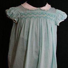 Polly Flinders smocked dresses with embroidery, puffed sleeves and Peter Pan collars. My mom use to dress my baby sister in these dresses!