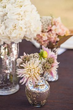 clusters of different size vases. We can mix up several vase sizes at tables.