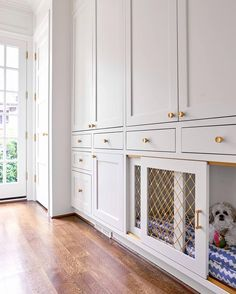 custom dog house by collins interiors | custom cabinets with brass hardware | mudroom design