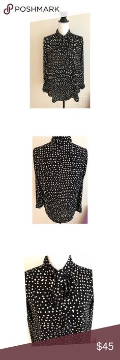 Banana Republic Polka Dot Neck Tie Blouse Shirt S Beautiful blouse from Banana Republic perfect from the office to the night out.  Intricate button detail on the sleeves. Buttons all the way down. Ties at neck. Worn only a handful of times and dry cleaned. Only selling because it's a little too small on my chest (I'm a 36C).   All items from smoke free home! Banana Republic Tops Blouses