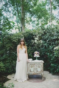Modern vintage wedding. Soft pastel shades, sense of lightness, innocence, playfulness, mystery. Lush vines and tall wispy trees. Whimsical, dreamy, and a bit un-real. Photography: Katie Pritchard.