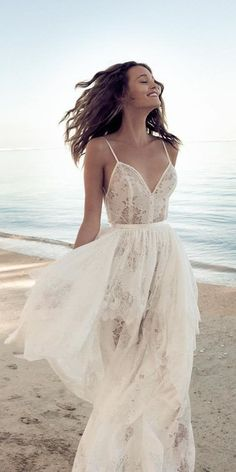 In general, the choice of beach wedding dresses is endless. Such a romantic type wedding is much deserving of a simple sexy wedding dress. Simple Sexy Wedding Dresses, Lace Beach Wedding Dress, Beach Wedding Photos, Lace Dress, Relaxed Wedding Dress, Ruffle Skirt, Wedding Pictures, 15 Dresses, Beach Dresses