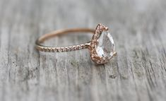 This is a trendy choice - the pear shaped diamond is beginning to make a comeback and rose gold is very popular at the moment!