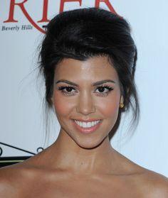 Kourtney Kardashian makeup: long lashes, volumizing mascara, peachy cheeks, nude lipstick (i.e., Shy Girl by MAC)