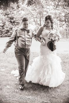 black and white, bw, b&w, walking down the aisle, rain, downpour, photography, rained out, adorable, groomsman, edge-e, wedding day, love, cute, rained, getting hitched, son, wedding photographer, photographer, white's wildwood retreat, eric, in love, wedding photography, edgeephoto, www.edgeephotography.com, edge-e photography, edgy, ceremony, Black & White, www.edgeephoto.com, wedding, wisconsin, edgee, beautiful, chippewa falls