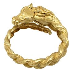 The perfect equestrian accent for holiday parties: vintage gold Hermes horse bracelet cuff.