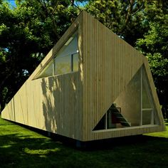 Guest artists will be invited to live and work inside this shard-like timber hut. New York architects 0 to 1 designed the faceted retreat for the garden of an established fine artist in south Finland. One large triangular window will allow daylight into a workspace inside, while a second will frame the outline of a