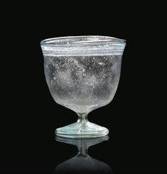 A ROMAN TRANSLUCENT PALE BLUE BLOWN GLASS GOBLET  4TH CENTURY A.D