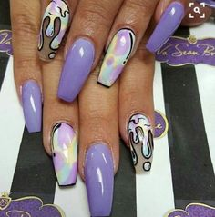 The Animated Coffin Nails. Not yet animated, but sort of animated coffin nail art design is next on the list to try. The Dripping water and the off rainbow colors seemed to be amazingly created on the coffin nails.
